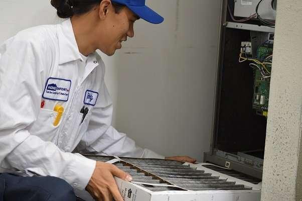 A technician fixing a heater