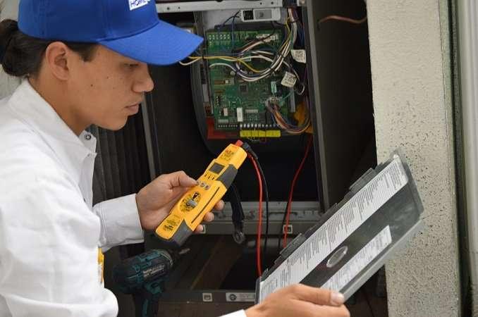 A technician diagnosing a heater