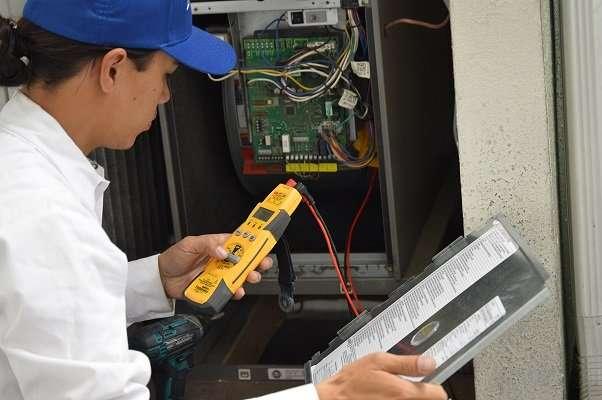 A tech repairing a heater