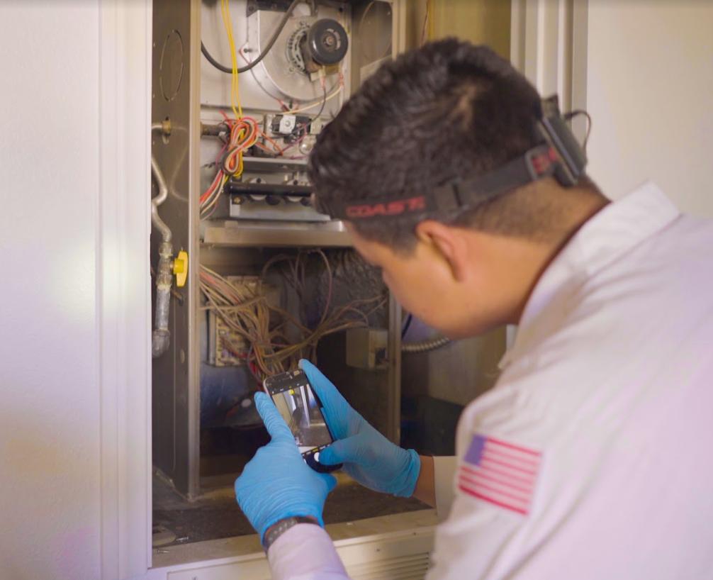 A technician repairing an air conditioner