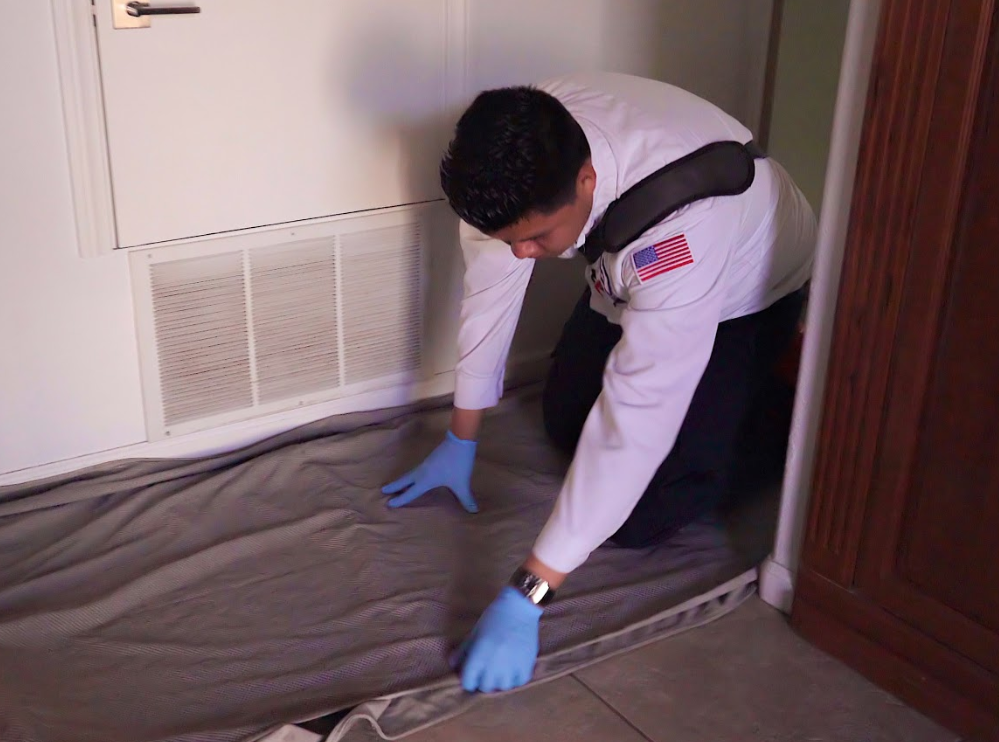 Air Conditioner technician preparing for an install in a home