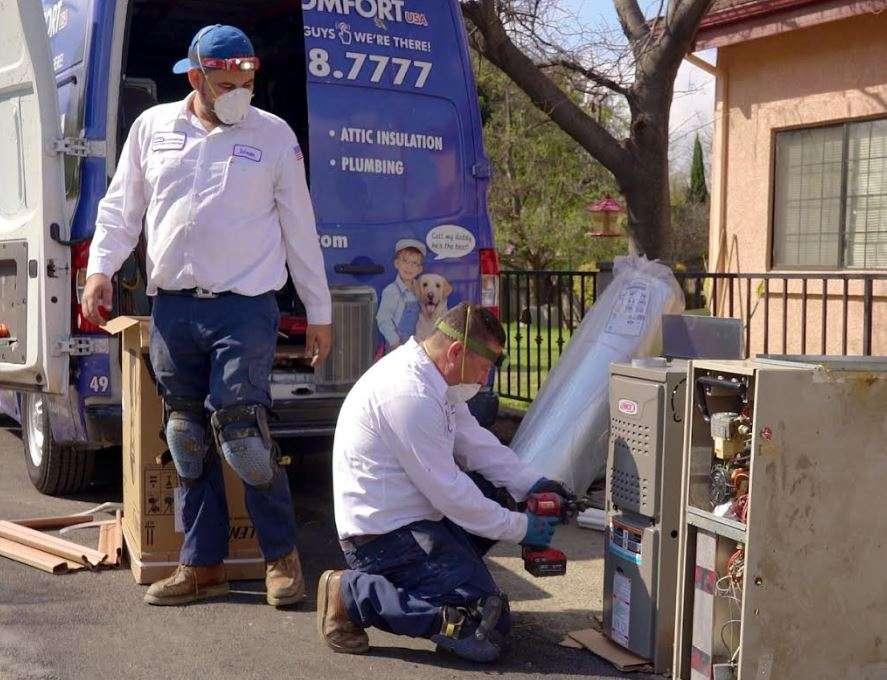 AC technicians installing a unit