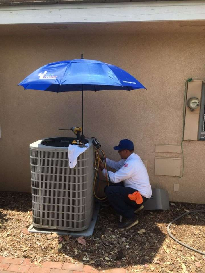 A technician doing maintenance on a unit