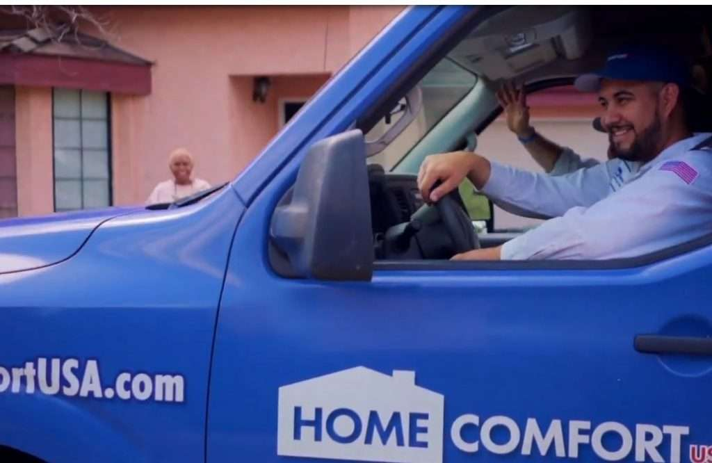 Air conditioner installer driving away