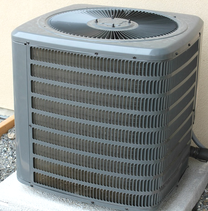 An air conditioner and heating unit outside of a house