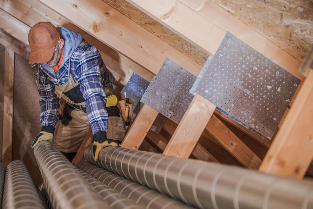 man doing HVAC installation in a house