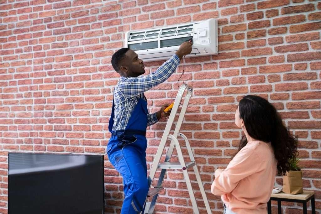 Tech doing an AC repair